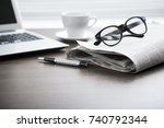 newspaper with computer on... | Shutterstock . vector #740792344