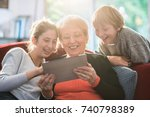 a dynamic grandmother and her... | Shutterstock . vector #740798389