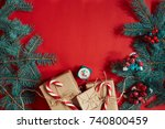 fir branch and gift box on red...   Shutterstock . vector #740800459