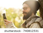 handsome man using mobile smart ... | Shutterstock . vector #740812531
