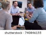group of a young business... | Shutterstock . vector #740846155