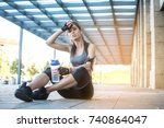 tired sporty girl with water...   Shutterstock . vector #740864047