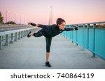sporty girl doing balance... | Shutterstock . vector #740864119