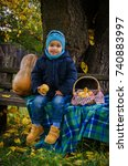boy of two years in a blue hat... | Shutterstock . vector #740883997