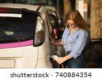 woman is charging rental... | Shutterstock . vector #740884354