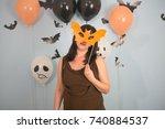 woman masquerade bat mask... | Shutterstock . vector #740884537