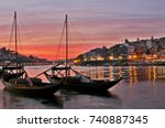 boats carrying barrels of porto ... | Shutterstock . vector #740887345