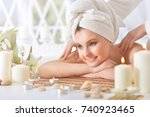 girl lying down on a massage bed | Shutterstock . vector #740923465