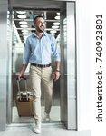 joyful stylish guy with stubble ... | Shutterstock . vector #740923801