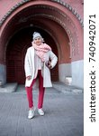 Small photo of Self-sufficient senior lady standing near historic building arch