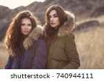 two beautiful woman in fashion... | Shutterstock . vector #740944111