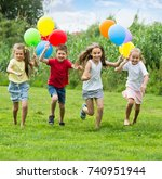 four glad kids happily playing... | Shutterstock . vector #740951944