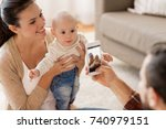 family  parenthood and people... | Shutterstock . vector #740979151