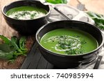 bowls with delicious spinach... | Shutterstock . vector #740985994
