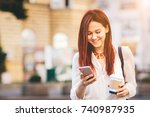 young woman with coffee to go...   Shutterstock . vector #740987935