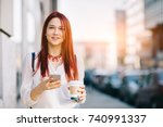 young woman with coffee to go... | Shutterstock . vector #740991337
