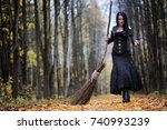 a woman in a witch suit in a...   Shutterstock . vector #740993239