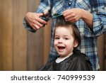 a little boy is trimmed in the... | Shutterstock . vector #740999539