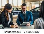 mature car dealer showing... | Shutterstock . vector #741008539