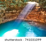 cenote samula sinkhole light... | Shutterstock . vector #741031099