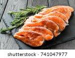 fresh salmon sliced on steaks... | Shutterstock . vector #741047977