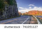 a muskoka country road winds... | Shutterstock . vector #741051127