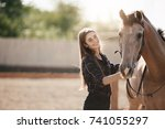 young female farm owner taking... | Shutterstock . vector #741055297