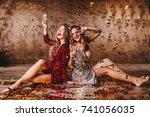 barefooted girls drinking... | Shutterstock . vector #741056035