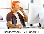 young man in the office with... | Shutterstock . vector #741065011