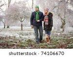 Couple On Winter Walk Through...
