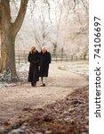 Senior Couple On Winter Walk...