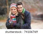 Couple On Romantic Winter Walk...