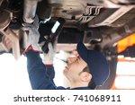 portrait of a mechanic...   Shutterstock . vector #741068911