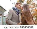 lovely happy couple walking on... | Shutterstock . vector #741080689