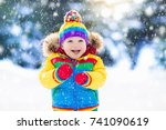 child playing with snow in... | Shutterstock . vector #741090619