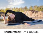 young girl doing yoga outdoors | Shutterstock . vector #741100831