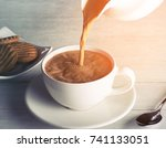 pouring hot tea into the tea... | Shutterstock . vector #741133051