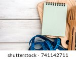 notepad on chopping board with ... | Shutterstock . vector #741142711