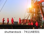 the oil workers are working | Shutterstock . vector #741148501