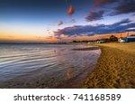 city skyline beach sunset...   Shutterstock . vector #741168589