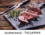 beef steak. roasted beef steak...   Shutterstock . vector #741169969