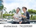 two businessman having a casual ... | Shutterstock . vector #741209389