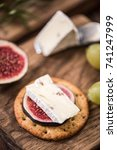 cheese crackers with camembert... | Shutterstock . vector #741247999