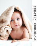 Stock photo little boy with a blanket on head 74124883