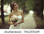 bride with a bouquet of flowers ... | Shutterstock . vector #741255109