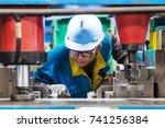 chinese engineers  working in... | Shutterstock . vector #741256384