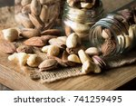 healthy mix nuts on wooden... | Shutterstock . vector #741259495