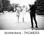 cheerful guests at the wedding | Shutterstock . vector #741268201