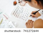 girl caligraph wrote with a pen ... | Shutterstock . vector #741272644