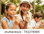 friends eating tasty ice cream... | Shutterstock . vector #741278485